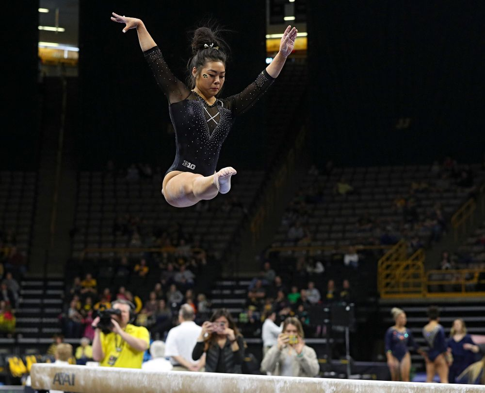 Iowa's Clair Kaji competes on the beam during their meet at Carver-Hawkeye Arena in Iowa City on Sunday, March 8, 2020. (Stephen Mally/hawkeyesports.com)