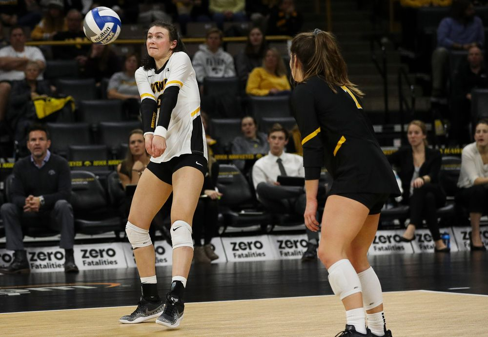 Iowa Hawkeyes defensive specialist Halle Johnston (4) bumps the ball during a match against Maryland at Carver-Hawkeye Arena on November 23, 2018. (Tork Mason/hawkeyesports.com)