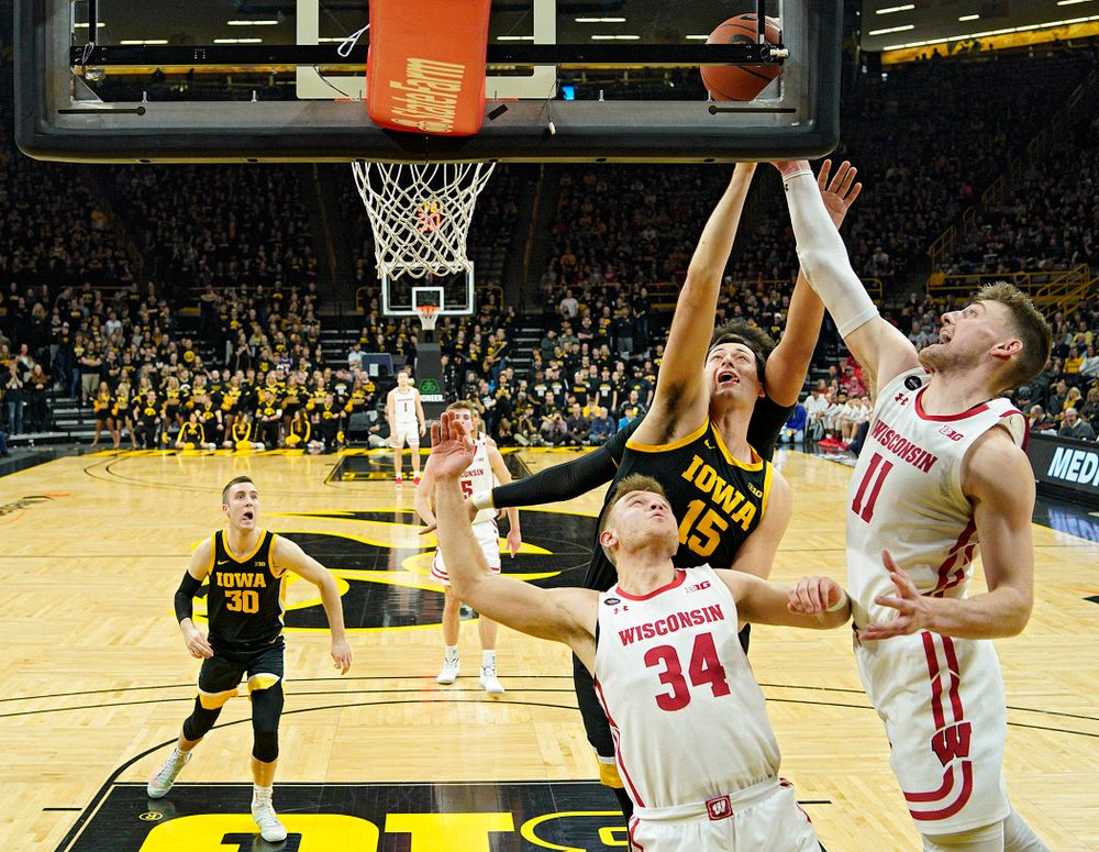 Iowa Hawkeyes forward Ryan Kriener (15) battles for a rebound during the first half of their game at Carver-Hawkeye Arena in Iowa City on Monday, January 27, 2020. (Stephen Mally/hawkeyesports.com)