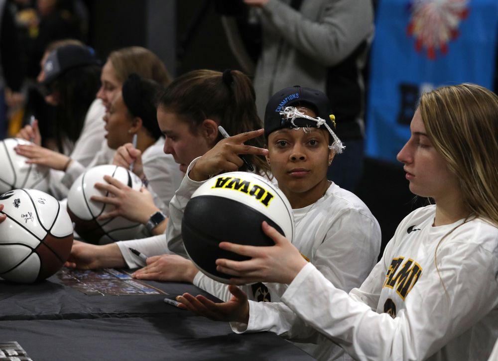 Iowa Hawkeyes guard Tania Davis (11) during a celebration of their Big Ten Women's Basketball Tournament championship Monday, March 18, 2019 at Carver-Hawkeye Arena. (Brian Ray/hawkeyesports.com)