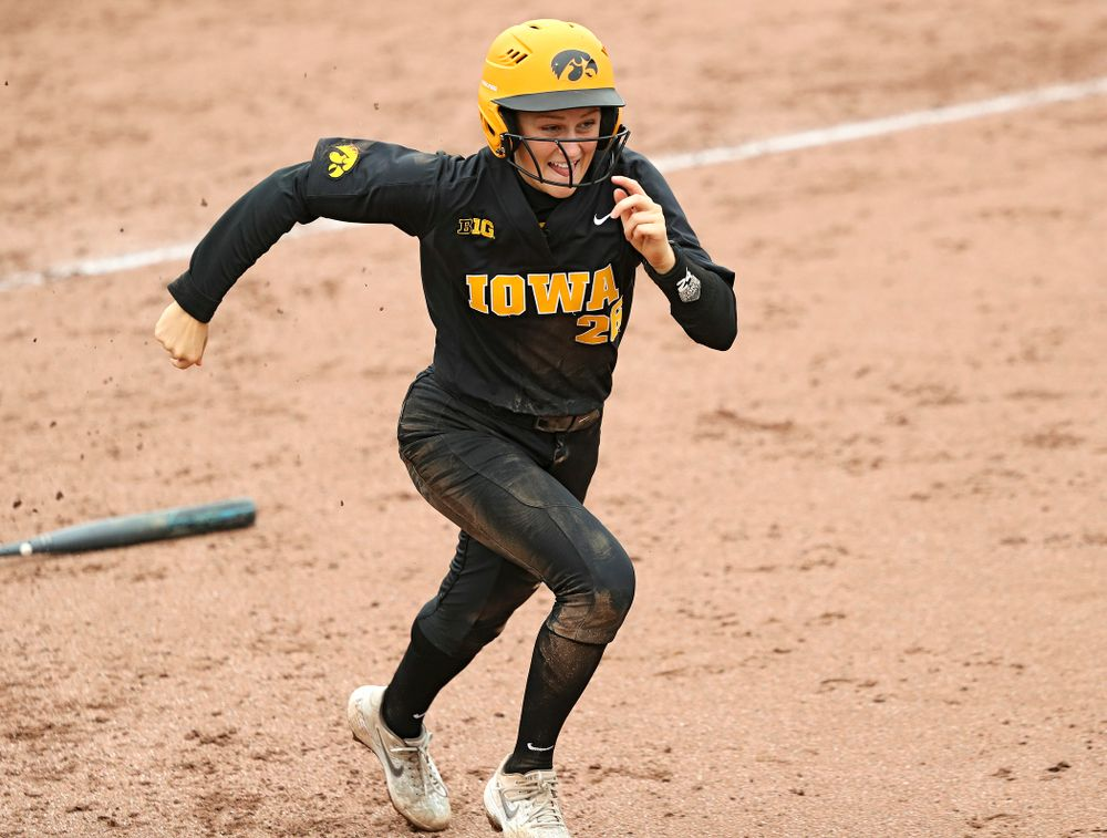 Iowa infielder Mia Ruther (26) runs to first during the fifth inning of their game against Iowa Softball vs Indian Hills Community College at Pearl Field in Iowa City on Sunday, Oct 6, 2019. (Stephen Mally/hawkeyesports.com)