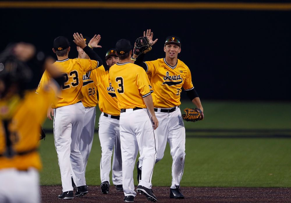 The gold team celebrates after winning game two.