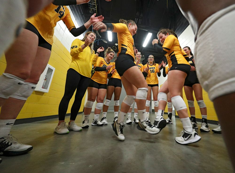 Iowa's Joslyn Boyer (1) and Emma Lowes (6) dance as the huddle before their match at Carver-Hawkeye Arena in Iowa City on Sunday, Oct 20, 2019. (Stephen Mally/hawkeyesports.com)