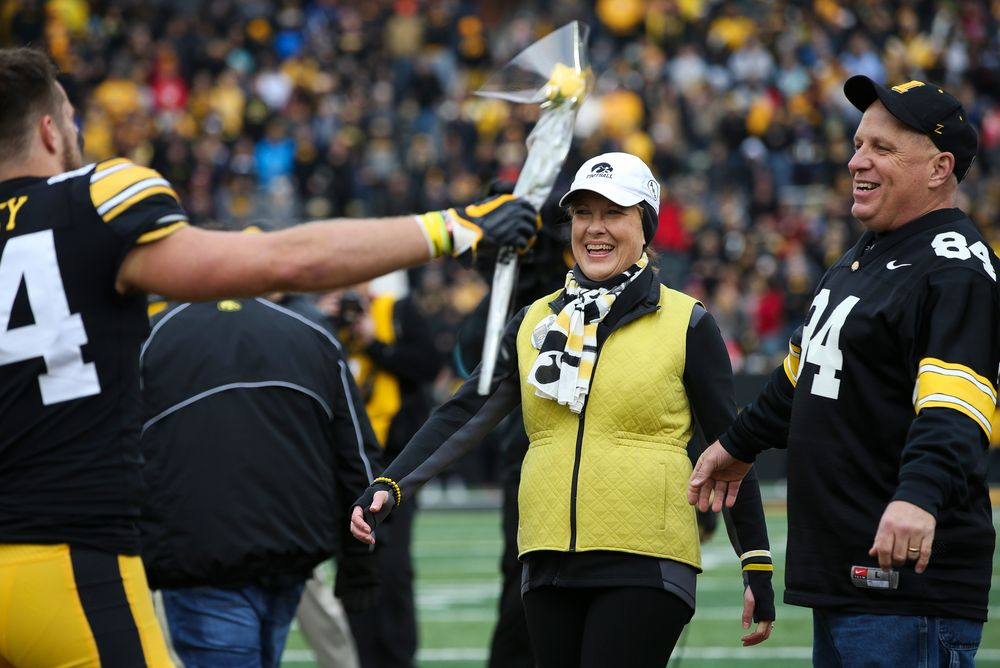 Iowa Hawkeyes wide receiver Nick Easley (84) is greeted by his parents during Senior Day ceremonies before a game against Nebraska at Kinnick Stadium on November 23, 2018. (Tork Mason/hawkeyesports.com)