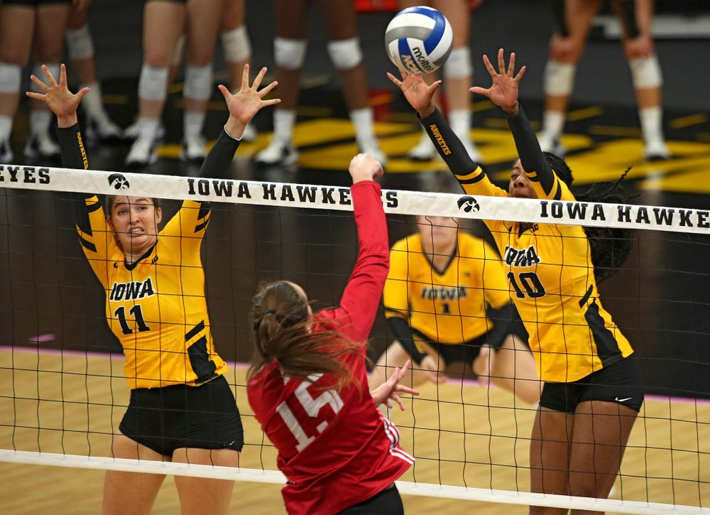 Iowa's Griere Hughes (10) tries to block a shot during their match at Carver-Hawkeye Arena in Iowa City on Sunday, Oct 20, 2019. (Stephen Mally/hawkeyesports.com)