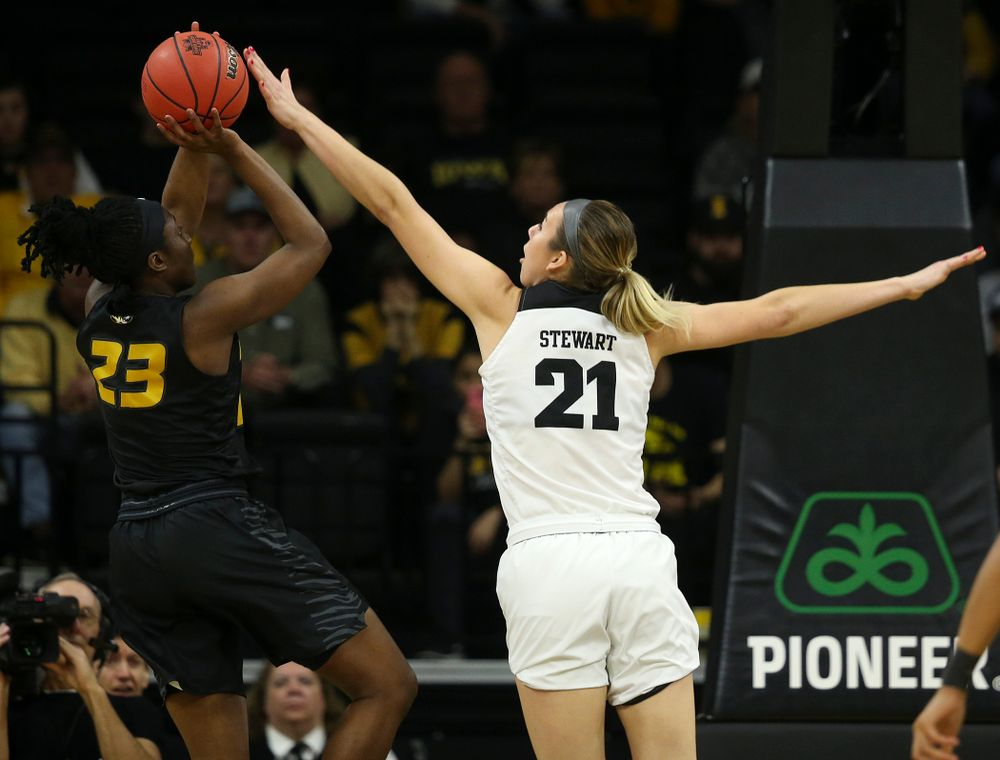 Iowa Hawkeyes forward Hannah Stewart (21) tries to get her hand on a shot by Missouri Tigers guard Amber Smith (23) during the first quarter of their second round game in the 2019 NCAA Women's Basketball Tournament at Carver Hawkeye Arena in Iowa City on Sunday, Mar. 24, 2019. (Stephen Mally for hawkeyesports.com)