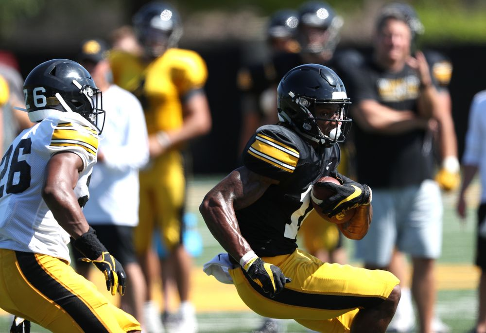Iowa Hawkeyes wide receiver Brandon Smith (12) during Fall Camp Practice No. 5 Tuesday, August 6, 2019 at the Ronald D. and Margaret L. Kenyon Football Practice Facility. (Brian Ray/hawkeyesports.com)