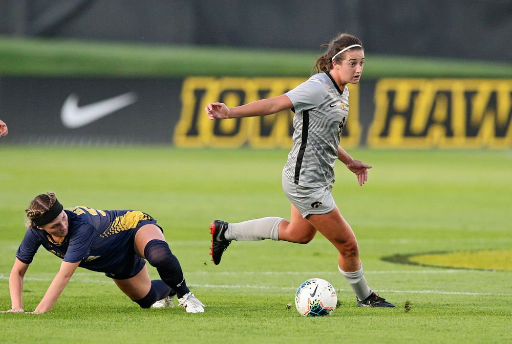 Iowa forward Kaleigh Haus (4) moves with the ball during the first half of their match at the Iowa Soccer Complex in Iowa City on Friday, Sep 13, 2019. (Stephen Mally/hawkeyesports.com)