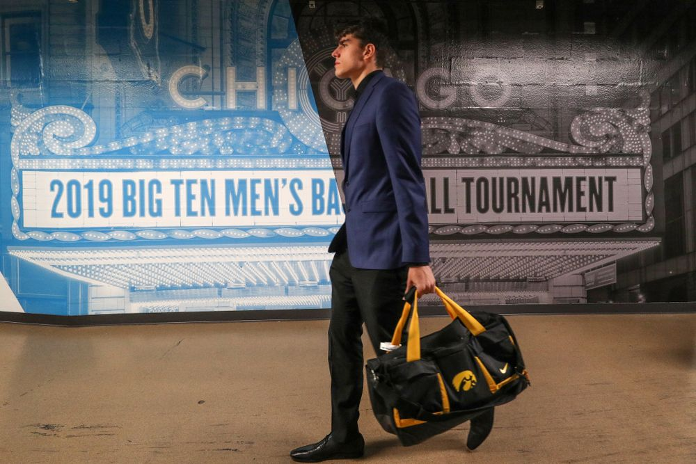 Iowa Hawkeyes forward Luka Garza (55) arrives for their game against the Illinois Fighting Illini in the 2019 Big Ten Men's Basketball Tournament Thursday, March 14, 2019 at the United Center in Chicago. (Brian Ray/hawkeyesports.com)