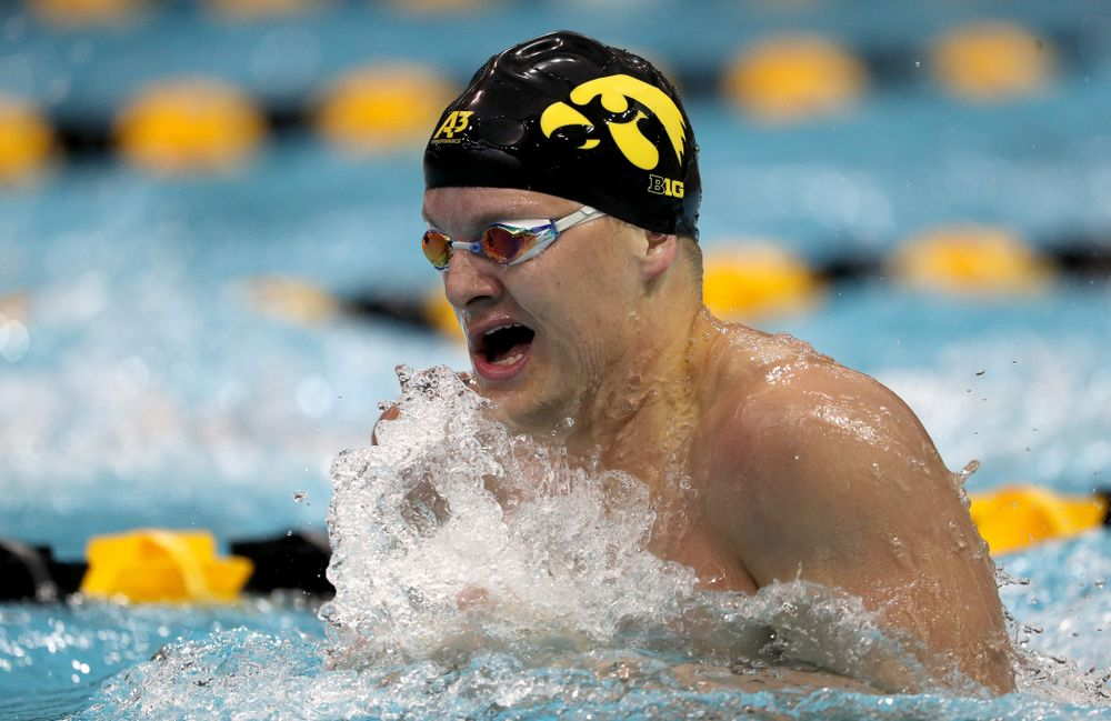 IowaÕs Will Myhre competes in the 100 yard breaststroke against Notre Dame and Illinois Saturday, January 11, 2020 at the Campus Recreation and Wellness Center.  (Brian Ray/hawkeyesports.com)