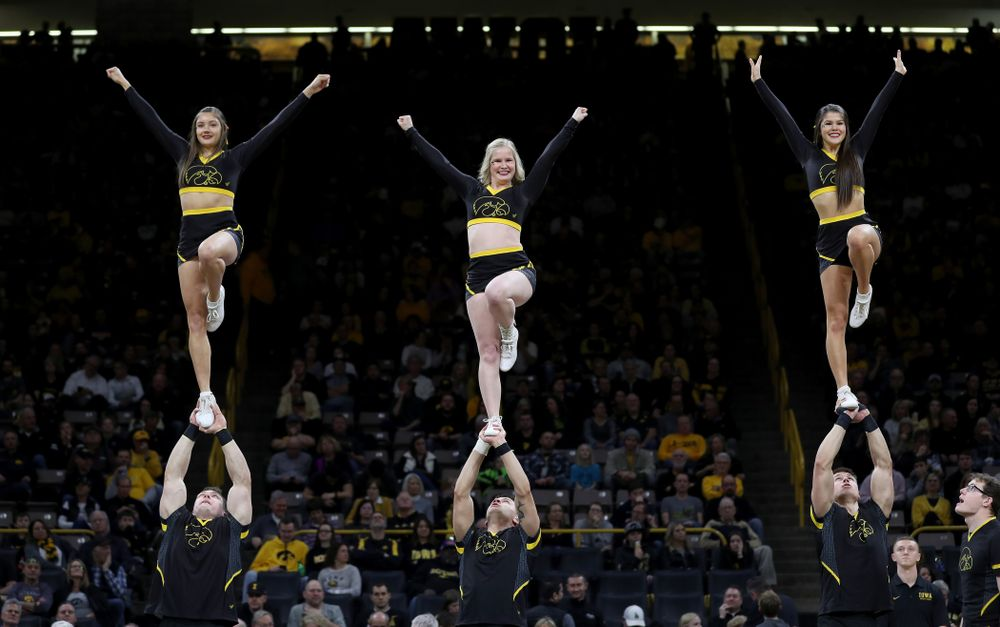 The Iowa Cheerleaders and Dance Team perform on senior night at half-time of the Iowa Hawkeyes game against the Purdue Boilermakers Tuesday, March 3, 2020 at Carver-Hawkeye Arena. (Brian Ray/hawkeyesports.com)
