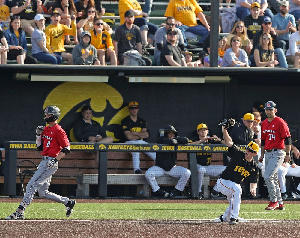 Iowa Hawkeyes first baseman Zeb Adreon (5) holds up his glove after digging out a throw as they turn a double play during the eighth inning of their game against Rutgers at Duane Banks Field in Iowa City on Saturday, Apr. 6, 2019. (Stephen Mally/hawkeyesports.com)