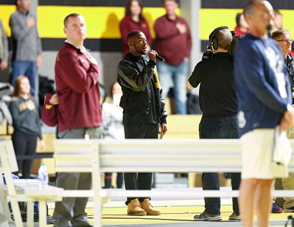 Iowa's Antonio Woodard sings the National Anthem during the Larry Wieczorek Invitational at the Recreation Building in Iowa City on Friday, January 17, 2020. (Stephen Mally/hawkeyesports.com)