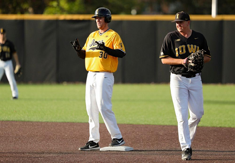 Iowa outfielder Connor McCaffery (30) celebrates after hitting a 2-run double during the fourth inning of the first game of the Black and Gold Fall World Series at Duane Banks Field in Iowa City on Tuesday, Oct 15, 2019. (Stephen Mally/hawkeyesports.com)