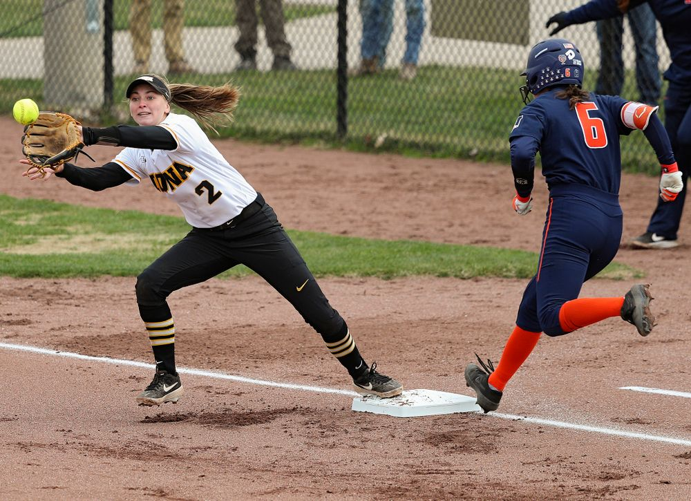 Iowa second baseman Aralee Bogar (2) reaches to pull in a throw as she covers first base on a bunt during the first inning of their game against Illinois at Pearl Field in Iowa City on Friday, Apr. 12, 2019. (Stephen Mally/hawkeyesports.com)