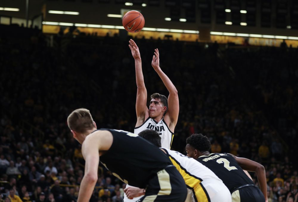 Iowa Hawkeyes forward Luka Garza (55) sets the school record for most points in a season against the Purdue Boilermakers Tuesday, March 3, 2020 at Carver-Hawkeye Arena. (Brian Ray/hawkeyesports.com)