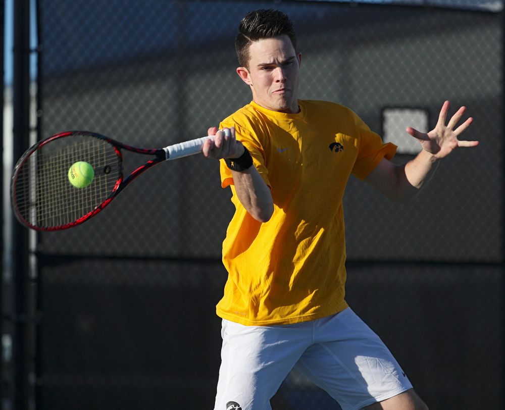 Iowa's Jonas Larsen during their doubles match again Michigan State at the Hawkeye Tennis and Recreation Complex in Iowa City on Friday, Apr. 19, 2019. (Stephen Mally/hawkeyesports.com)
