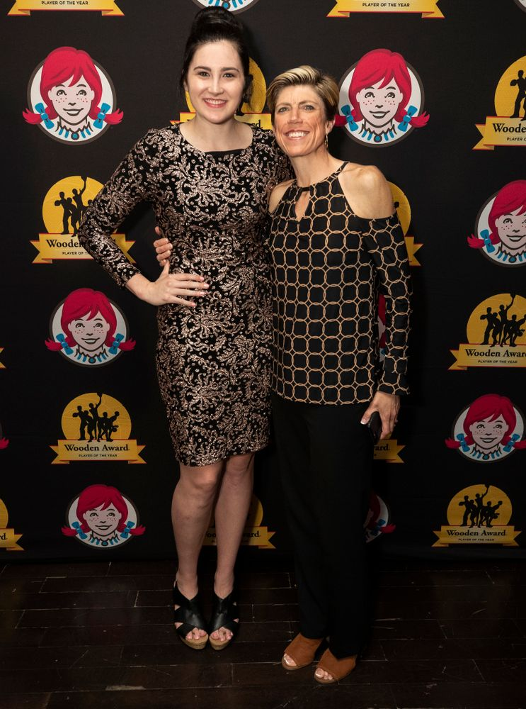 Iowa Hawkeyes forward Megan Gustafson (10) and associate head coach Jan Jensen on the red carpet before the ESPN College Basketball Awards show Friday, April 12, 2019 at The Novo at LA Live.  (Brian Ray/hawkeyesports.com)