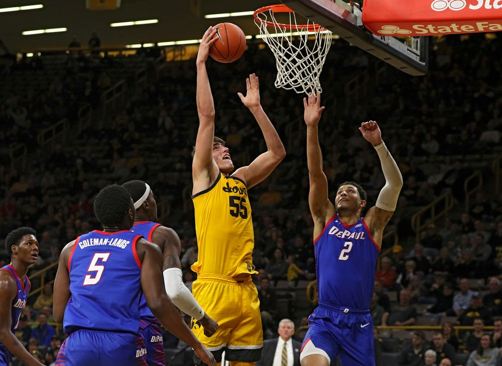 Iowa Hawkeyes center Luka Garza (55) scores a basket during the second half of their game at Carver-Hawkeye Arena in Iowa City on Monday, Nov 11, 2019. (Stephen Mally/hawkeyesports.com)
