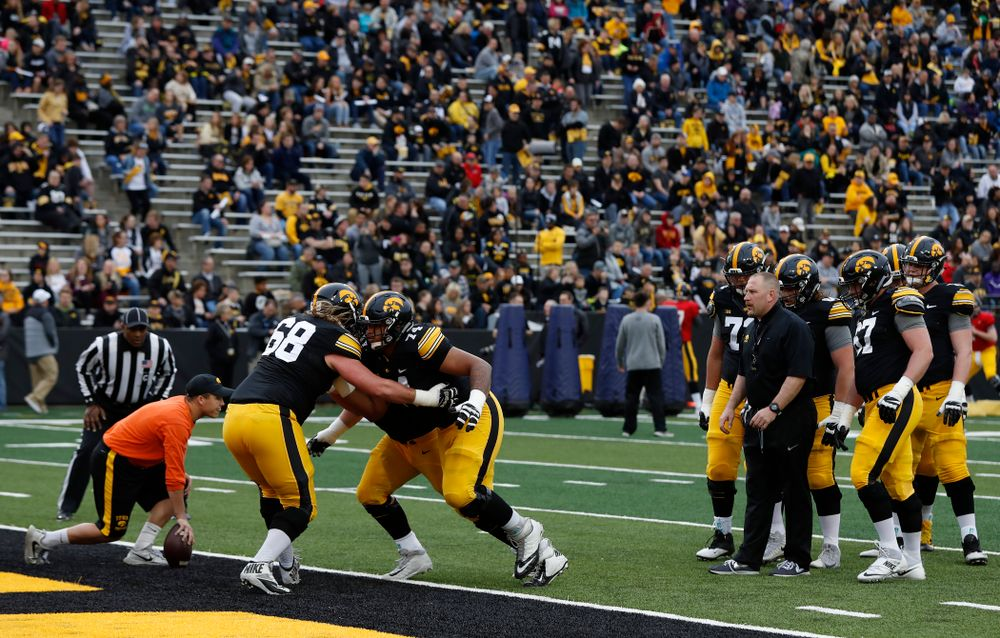 Iowa Hawkeyes offensive lineman Tristan Wirfs (74) and offensive lineman Landan Paulsen (68) during the final spring practice Friday, April 20, 2018 at Kinnick Stadium. (Brian Ray/hawkeyesports.com)