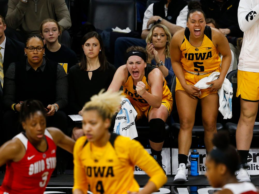 Iowa Hawkeyes forward Megan Gustafson (10) and Iowa Hawkeyes guard Alexis Sevillian (5) react to a made basket on the bench during a game against the Ohio State Buckeyes at Carver-Hawkeye Arena on January 25, 2018. (Tork Mason/hawkeyesports.com)