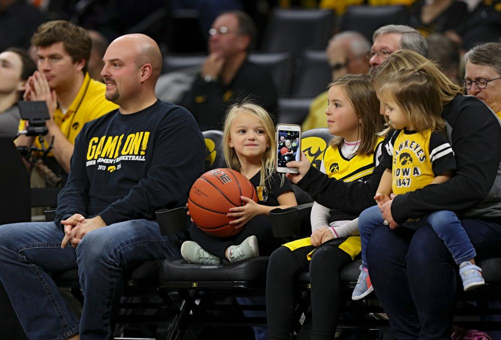 A young fan holds the game ball for the officials between the first and second quarter of Iowa's overtime win against Princeton at Carver-Hawkeye Arena in Iowa City on Wednesday, Nov 20, 2019. (Stephen Mally/hawkeyesports.com)