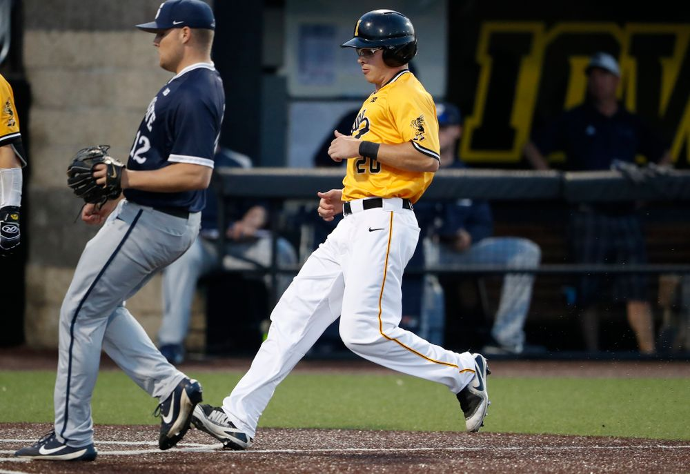 Iowa Hawkeyes catcher Austin Guzzo (20) scores against the Penn State Nittany Lions Saturday, May 19, 2018 at Duane Banks Field. (Brian Ray/hawkeyesports.com)