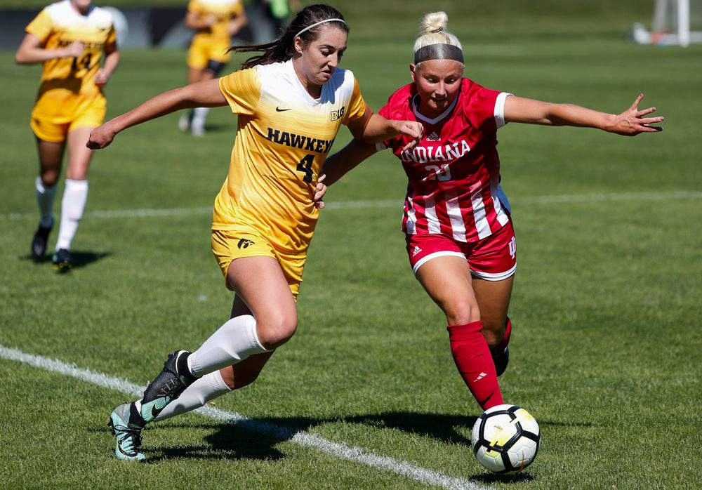 Iowa Hawkeyes forward Kaleigh Haus (4) battles for possession during a game against Indiana at the Iowa Soccer Complex on September 23, 2018. (Tork Mason/hawkeyesports.com)