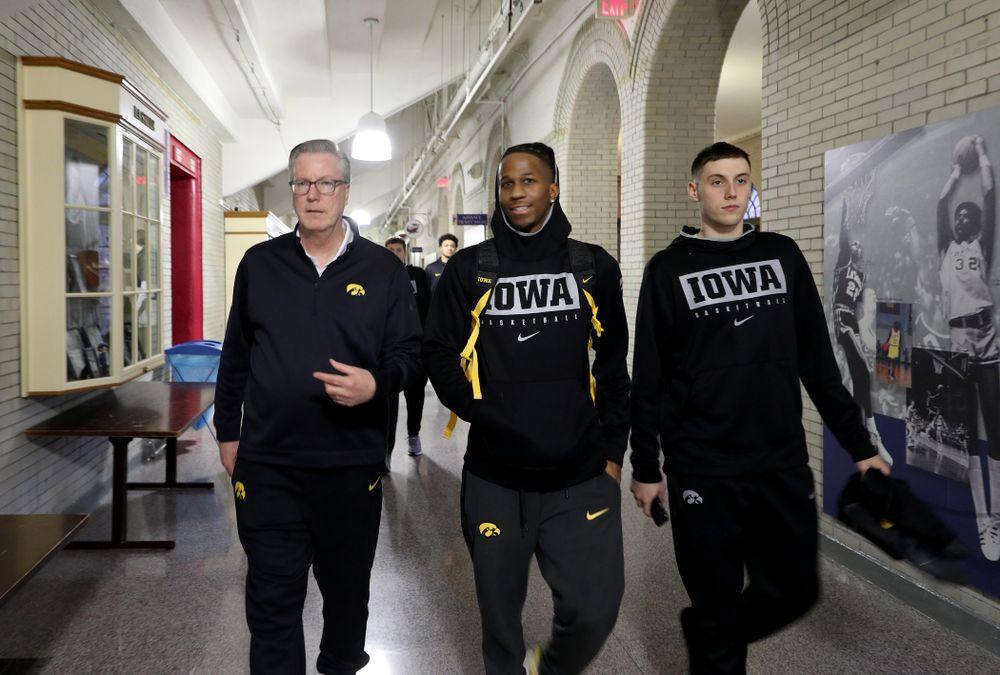 Iowa Hawkeyes head coach Fran McCaffery, guard Bakari Evelyn (4), and guard CJ Fredrick (5) arrive for practice at the Palestra Friday, January 3, 2020 in Philadelphia. (Brian Ray/hawkeyesports.com)