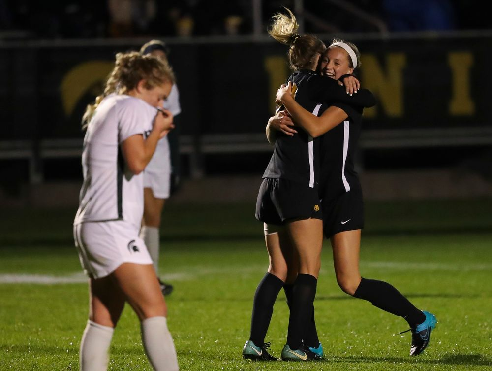 Iowa Hawkeyes midfielder Hailey Rydberg (2) and Iowa Hawkeyes midfielder Natalie Winters (10) celebrate after Rydberg's goal during a game against Michigan State at the Iowa Soccer Complex on October 12, 2018. (Tork Mason/hawkeyesports.com)