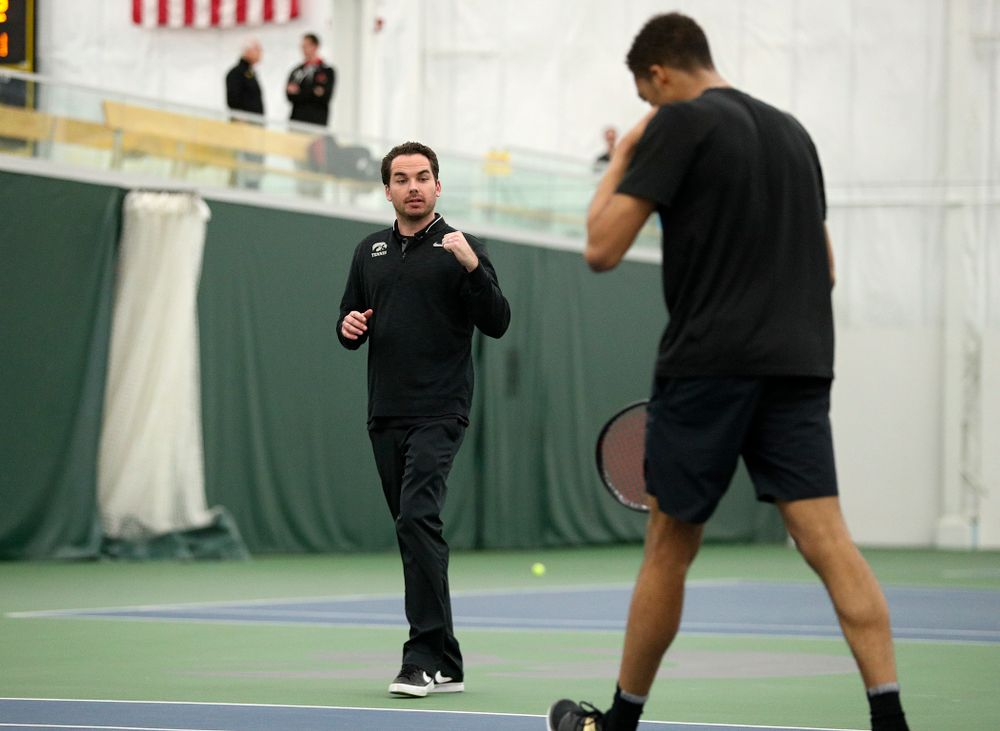 Mellecker Family Head Men's Tennis Coach Ross Wilson (from left) celebrates with Oliver Okonkwo during his singles match at the Hawkeye Tennis and Recreation Complex in Iowa City on Friday, March 6, 2020. (Stephen Mally/hawkeyesports.com)