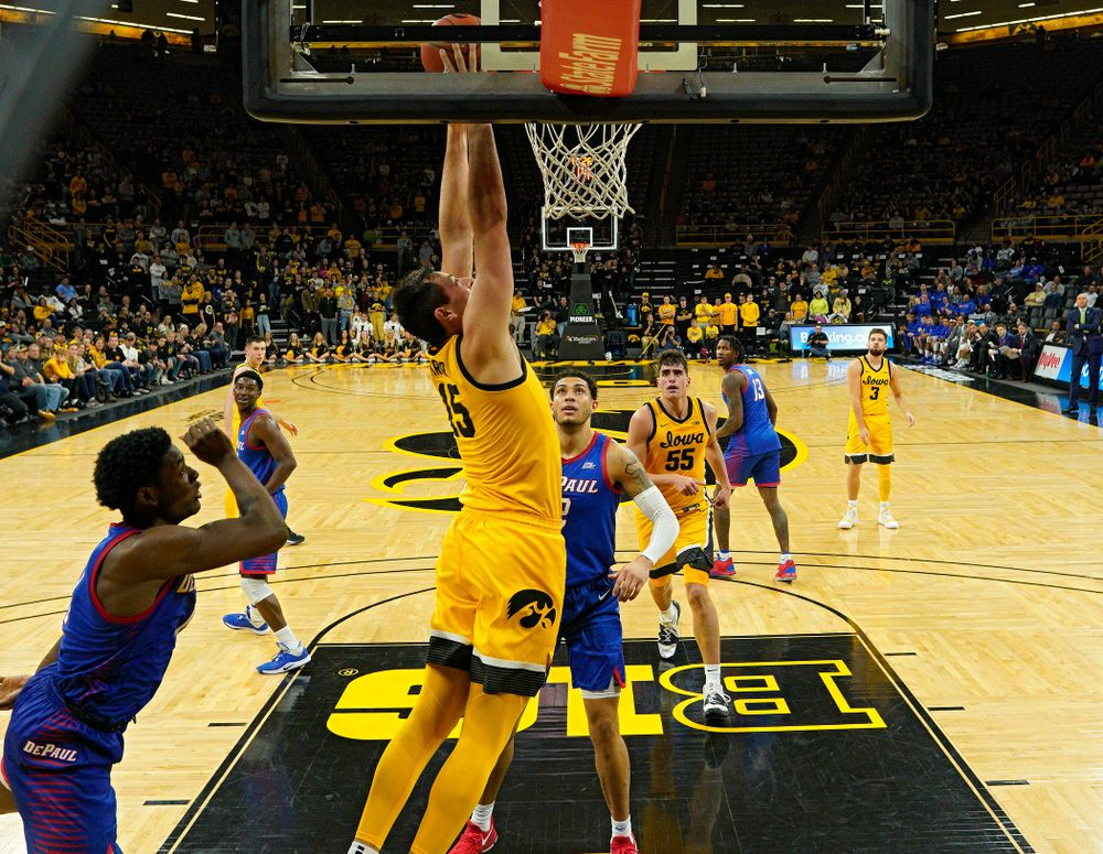 Iowa Hawkeyes forward Ryan Kriener (15) dunks the ball during the second half of their game at Carver-Hawkeye Arena in Iowa City on Monday, Nov 11, 2019. (Stephen Mally/hawkeyesports.com)