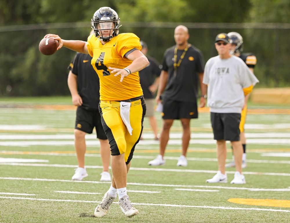Iowa Hawkeyes quarterback Nate Stanley (4) throws on the run during Fall Camp Practice No. 10 at the Hansen Football Performance Center in Iowa City on Tuesday, Aug 13, 2019. (Stephen Mally/hawkeyesports.com)