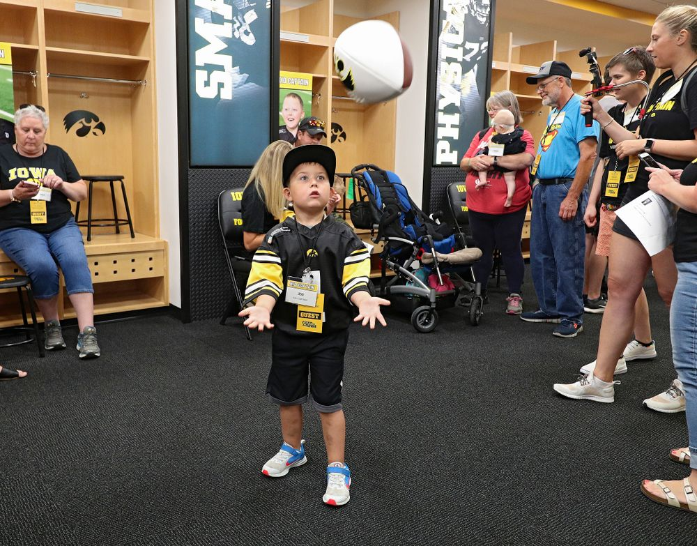 Kid Captain Jeg Weets plays catch in the Iowa locker room during Kids Day at Kinnick Stadium in Iowa City on Saturday, Aug 10, 2019. (Stephen Mally/hawkeyesports.com)