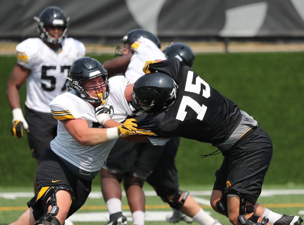 Iowa Hawkeyes defensive end Austin Schulte (74) against offensive lineman Jeff Jenkins (75) during the third practice of fall camp Sunday, August 5, 2018 at the Kenyon Football Practice Facility. (Brian Ray/hawkeyesports.com)