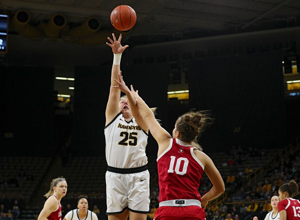 Iowa Hawkeyes forward Monika Czinano (25) scores a basket during the first quarter of their game at Carver-Hawkeye Arena in Iowa City on Sunday, January 12, 2020. (Stephen Mally/hawkeyesports.com)