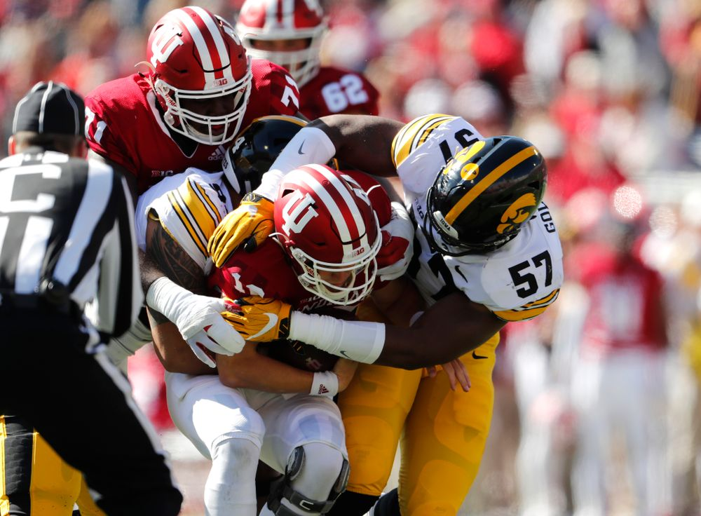 Iowa Hawkeyes defensive end A.J. Epenesa (94) and defensive end Chauncey Golston (57) against the Indiana Hoosiers Saturday, October 13, 2018 at Memorial Stadium, in Bloomington, Ind. (Brian Ray/hawkeyesports.com)