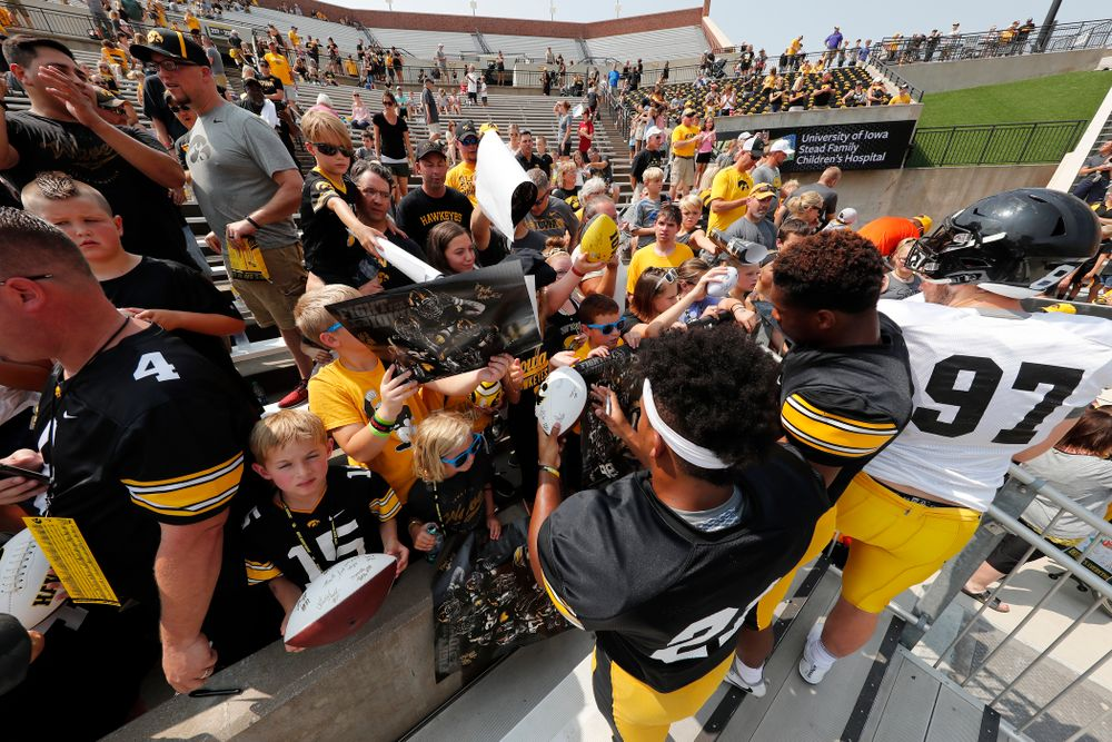 Iowa Hawkeyes running back Ivory Kelly-Martin (21) and wide receiver Tyrone Tracy Jr. (3) sign autographs during Kids Day Saturday, August 11, 2018 at Kinnick Stadium. (Brian Ray/hawkeyesports.com)