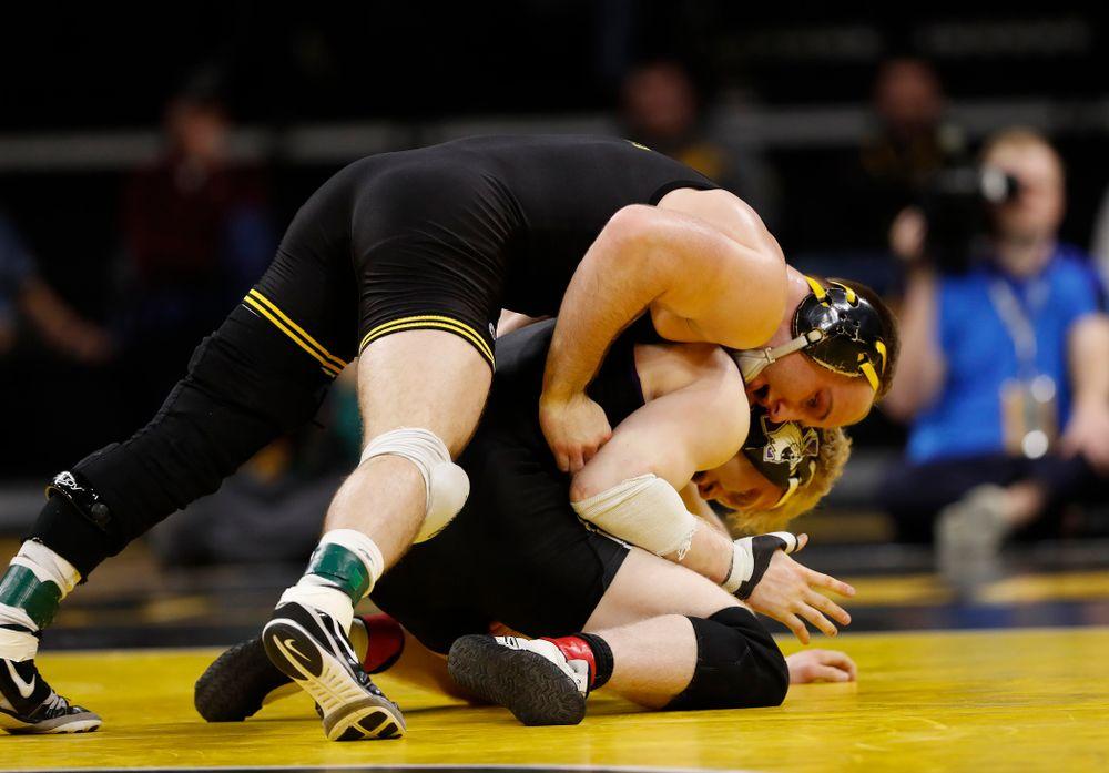 Iowa's Alex Marinelli wrestles Northwestern's Michael Sepke at 165 pounds