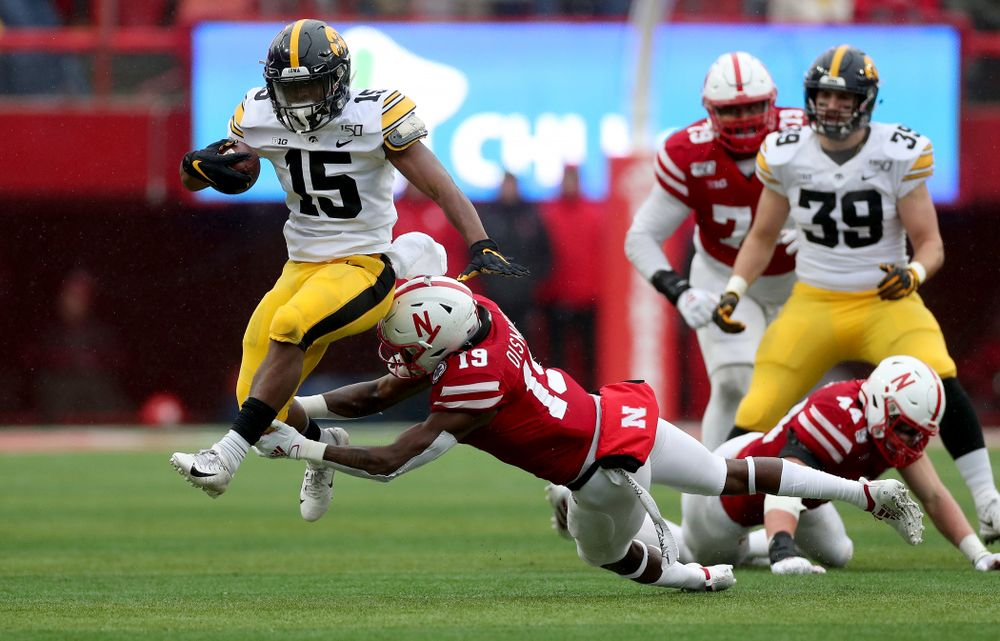 Iowa Hawkeyes running back Tyler Goodson (15) braces a tackle on his way to a touchdown against the Nebraska Cornhuskers Friday, November 29, 2019 at Memorial Stadium in Lincoln, Neb. (Brian Ray/hawkeyesports.com)