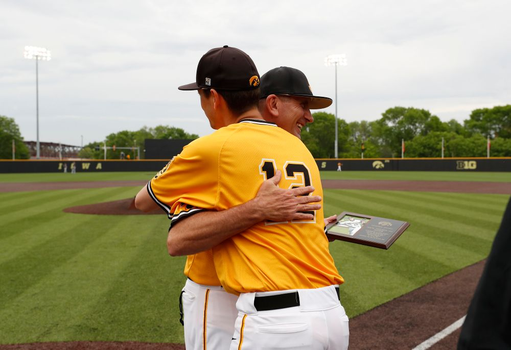 Iowa Hawkeyes pitcher Nick Nelsen (12) and head coach Rick Heller during senior day activities before their game against the Penn State Nittany Lions Saturday, May 19, 2018 at Duane Banks Field. (Brian Ray/hawkeyesports.com)