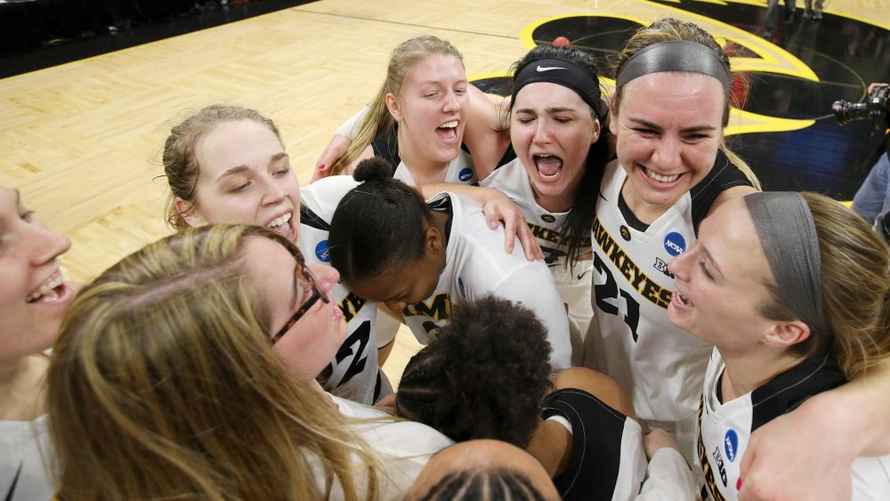 The Iowa Hawkeyes celebrate after winning their second round game in the 2019 NCAA Women's Basketball Tournament at Carver Hawkeye Arena in Iowa City on Sunday, Mar. 24, 2019. (Stephen Mally for hawkeyesports.com)