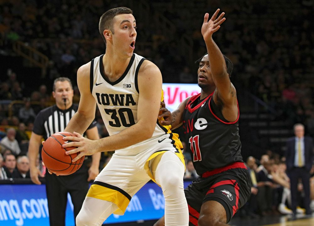 Iowa Hawkeyes guard Connor McCaffery (30) looks to pass during the first half of their game at Carver-Hawkeye Arena in Iowa City on Friday, Nov 8, 2019. (Stephen Mally/hawkeyesports.com)