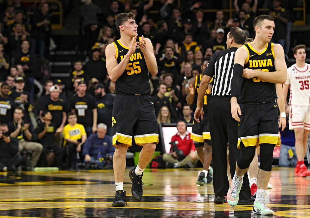 Iowa Hawkeyes center Luka Garza (55) claps during the second half of their game at Carver-Hawkeye Arena in Iowa City on Monday, January 27, 2020. (Stephen Mally/hawkeyesports.com)