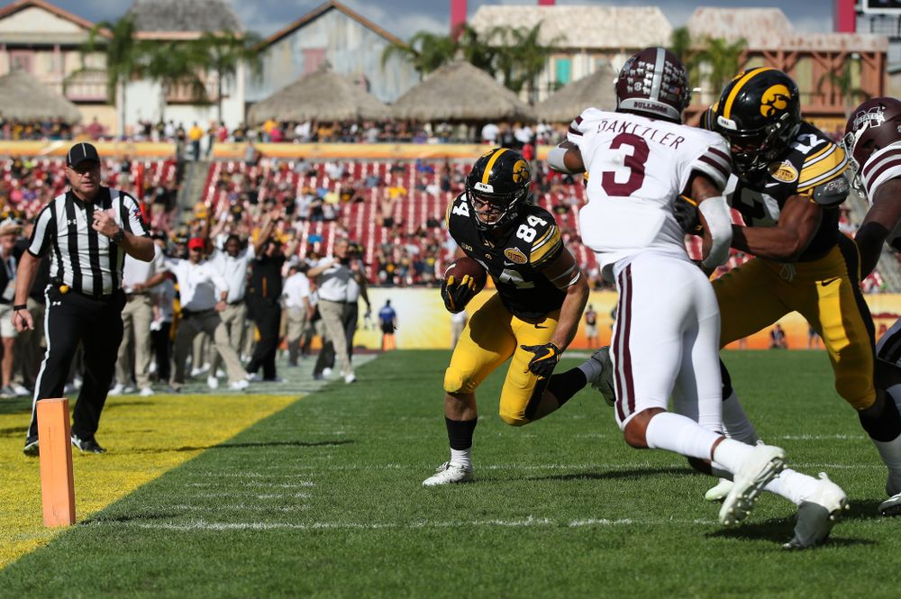 Iowa Hawkeyes wide receiver Nick Easley (84) scores during the Outback Bowl Tuesday, January 1, 2019 at Raymond James Stadium in Tampa, FL. (Brian Ray/hawkeyesports.com)
