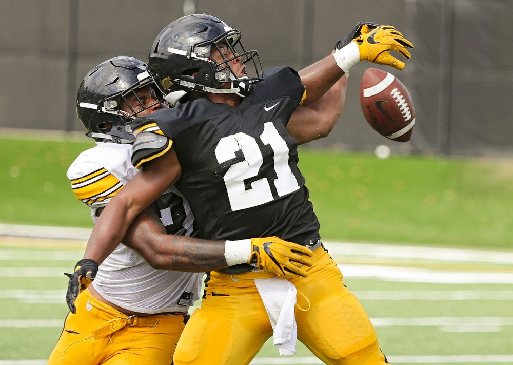 Iowa Hawkeyes linebacker Djimon Colbert (32) breaks up a pass intended for running back Ivory Kelly-Martin (21) during Fall Camp Practice No. 11 at the Hansen Football Performance Center in Iowa City on Wednesday, Aug 14, 2019. (Stephen Mally/hawkeyesports.com)