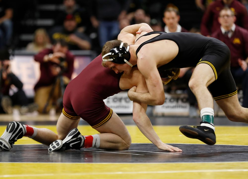 Iowa's Carter Happel wrestles Minnesota's Tommy Thorn at 141 pounds