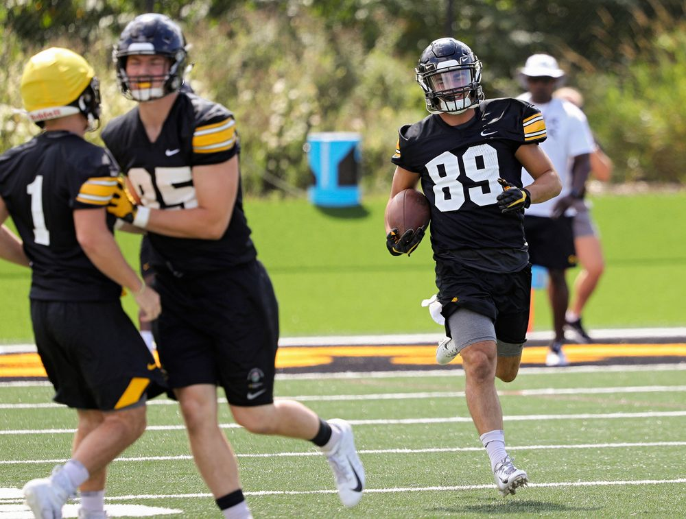 Iowa Hawkeyes wide receiver Nico Ragaini (89) smiles as he carries the ball while they work on a kick return drill during Fall Camp Practice No. 13 at the Hansen Football Performance Center in Iowa City on Friday, Aug 16, 2019. (Stephen Mally/hawkeyesports.com)