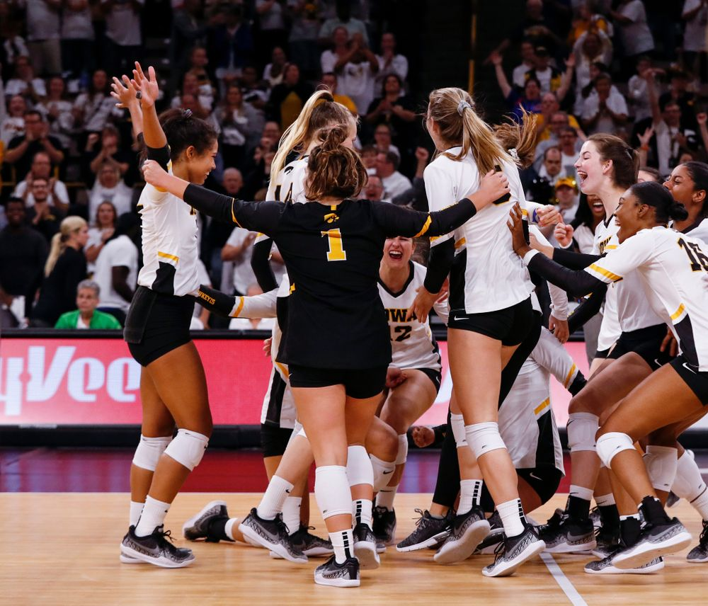 The Iowa Hawkeyes celebrate after defeating the Michigan State Spartans Friday, September 21, 2018 at Carver-Hawkeye Arena. (Brian Ray/hawkeyesports.com)