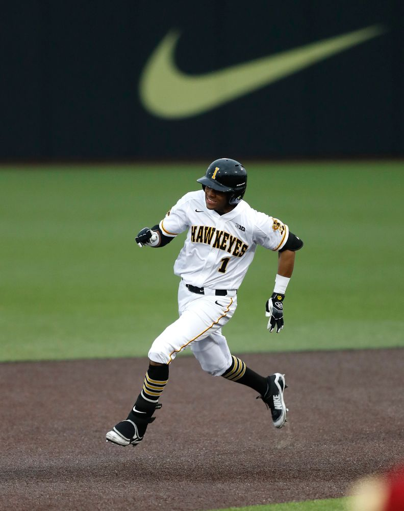Iowa Hawkeyes third baseman Lorenzo Elion (1) triples against Coe College Wednesday, April 11, 2018 at Duane Banks Field. (Brian Ray/hawkeyesports.com)